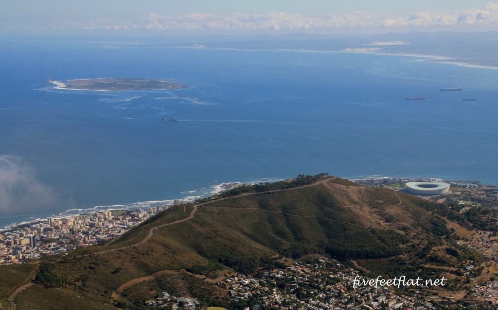 That's Robben Island in the top left and round object is Cape Town Stadium